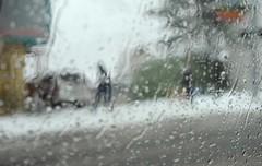 Snowy walk, rain drops on the window, mid-winter, Greenwood Ave, Seattle, Washington, USA