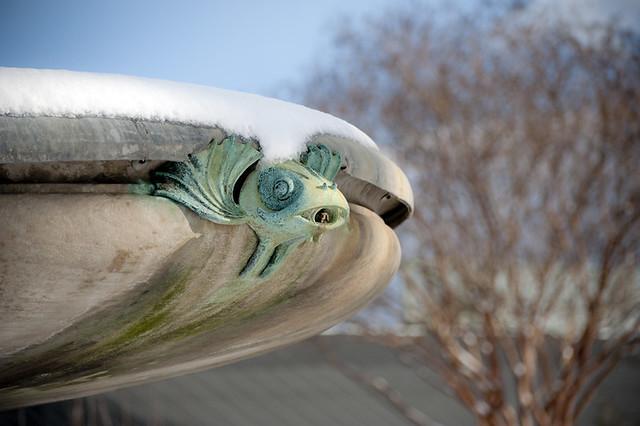 Art deco fish detail on Jenkings Fountain at Brooklyn Botanic Garden in winter snow