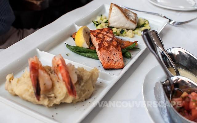 Trio of fresh fish: prawns, Sockeye salmon, halibut, served with pico de gallo, beurre blanc