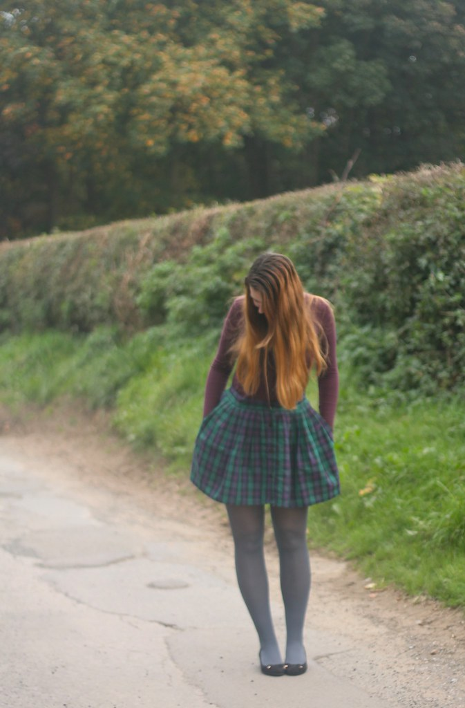 Roll neck jumper with tartan skirt