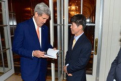 U.S. Secretary of State John Kerry greets Shin Dong-hyuk, a survivor of North Korean human rights abuses, before participating in an event highlighting human rights abuses in the Democratic People's Republic of Korea in New York City on September 23, 2014. The Secretary is participating in events in conjunction with the 69th Session of the United Nations General Assembly. [State Department photo/ Public Domain]