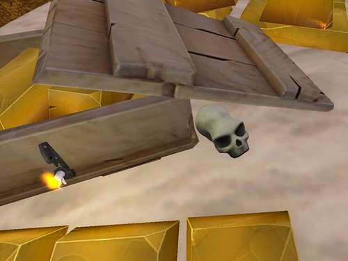 Image Description: Long skull under the edge of an opened lid to a container full of gold bars.