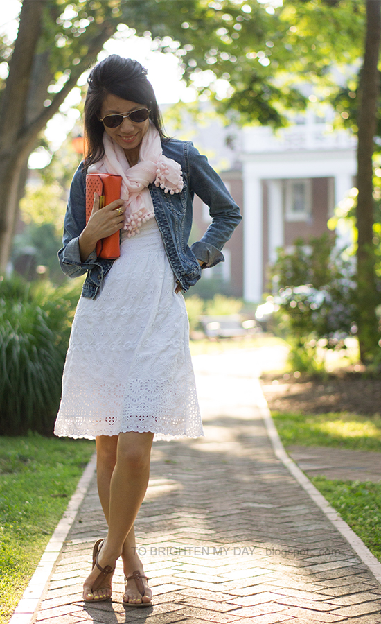 light pink scarf, white eyelet dress, orange clutch