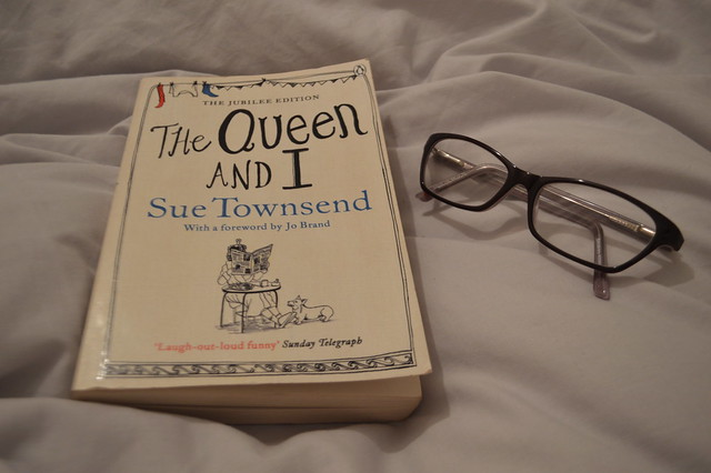 This is a photo of a book and a pair of reading glasses.
