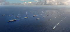 Forty-two ships and submarines representing 15 international partner nations manuever into a close formation during RIMPAC 2014. (U.S. Navy/MC1 Shannon Renfroe)