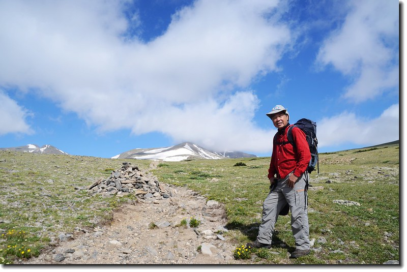 At the top of St. Mary's Glacier, background is James Peak