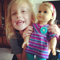 She is in love with her new @americangirlbrand doll from her auntie!! One happy girl. #birthday #littlemommy