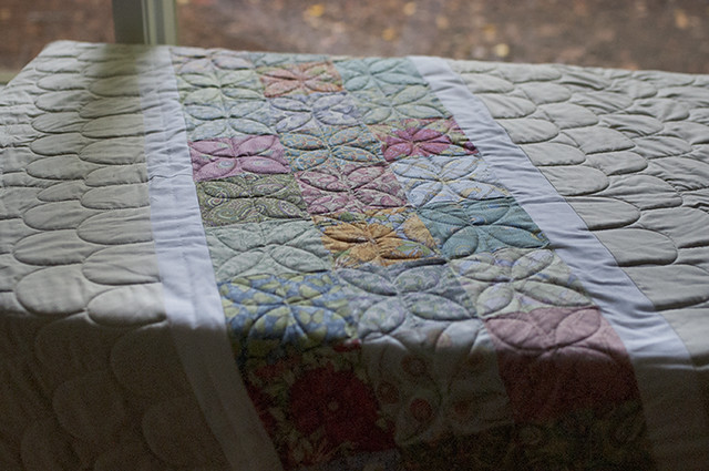 Clamshell and Dogwood Quilting on table