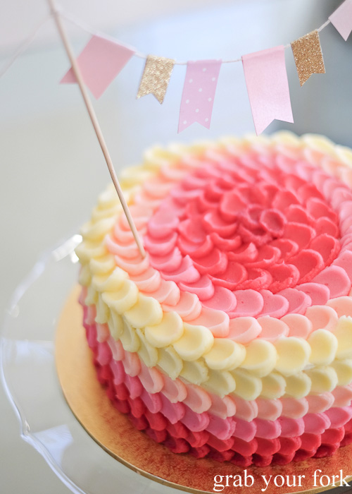 Petal buttercream icing on the lychee jasmine pink ombre cake