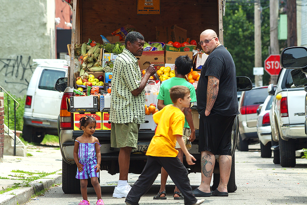 Man-selling-produce-from-back-of-truck-on-6-8-14--South-Philly