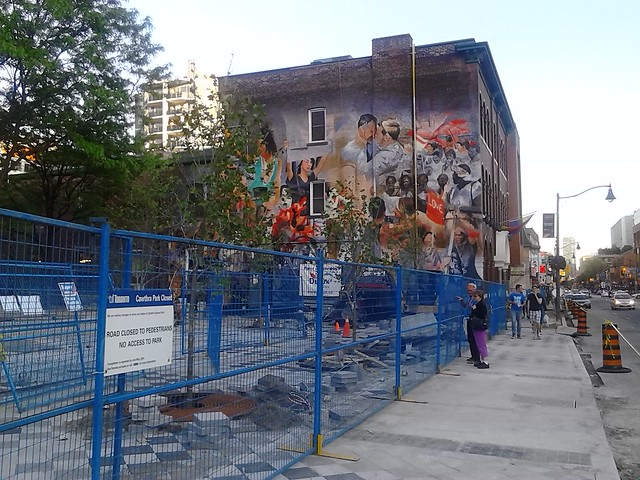 The mural on the north side of the 519 Community Centre takes shape