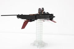 assault rifle(0.0), rifle(0.0), firearm(0.0), gun(0.0), gun barrel(0.0), weapon(1.0), machine gun(1.0),