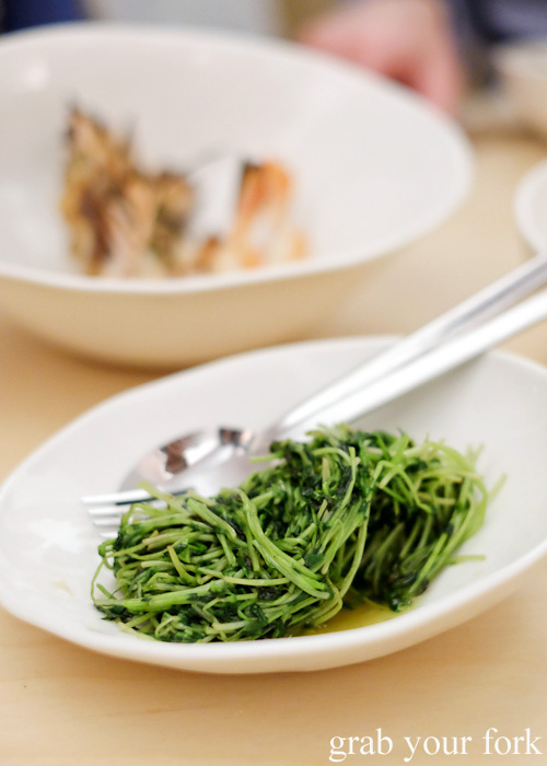 Snow pea sprouts with garlic oil at Potts Point, Sydney