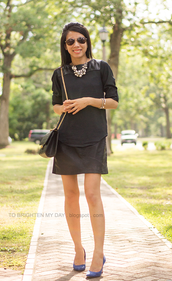black faux leather yoke top over faux leather dress, pearl cluster necklace, blue suede pumps