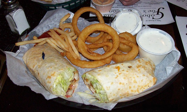 chicken wrap with rings and fries