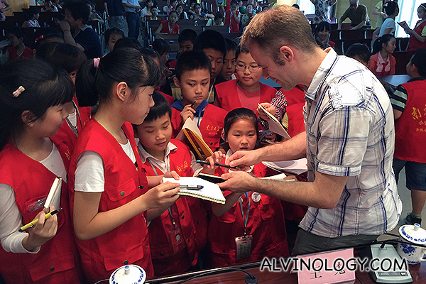 Rodolphe getting the celebrity treatment from Chinese kids during a press event