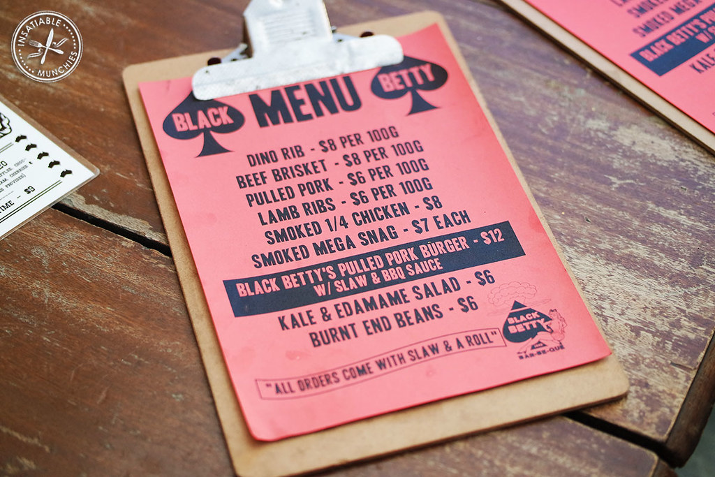 A short list of what they have to offer, with prices, is printed on red paper and placed on a clipboard.