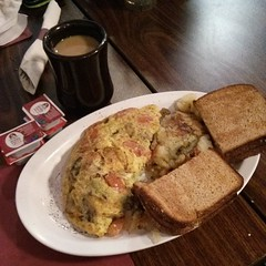 tomato, mushroom, and avocado omelette, toast, and home fries
