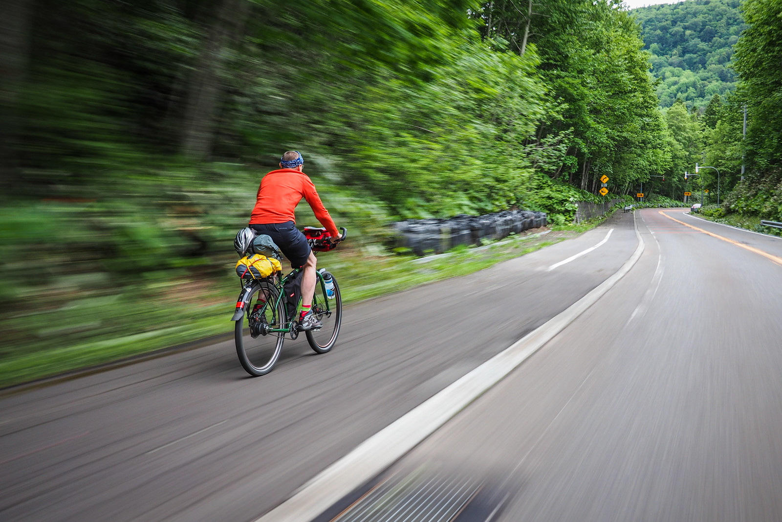Speeding downhill on a Genesis bicycle on the Lake Shikotsu Cycling Road (Sapporo, Japan)
