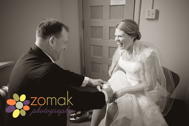 zo-mak photography captures a special emotional moment between the bride and her father