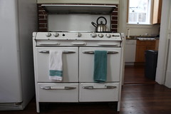 furniture(0.0), laundry room(0.0), laundry(0.0), floor(1.0), kitchen(1.0), room(1.0), property(1.0), cabinetry(1.0), apartment(1.0), home(1.0),
