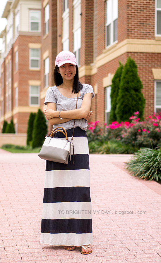 pink cap, gray tee, rugby striped maxi dress, colorblock crossbody bag
