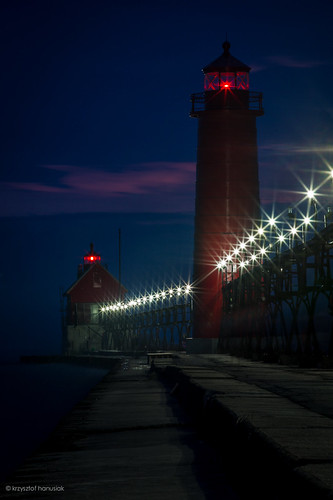 ocean nightphotography blue sunset sea sky lighthouse reflection water beautiful night clouds mi sunrise lights pier marine colorful unitedstates michigan horizon perspective lagoon lakemichigan direction nighttime maritime lanterns waters navigation molo grandhaven springlake leadinglines hanusiak