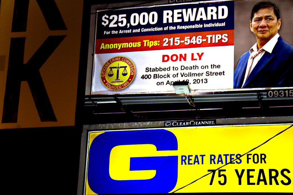 Reward-billboard-for-Don-Ly-who-was-stabbed-to-death--Italian-Market