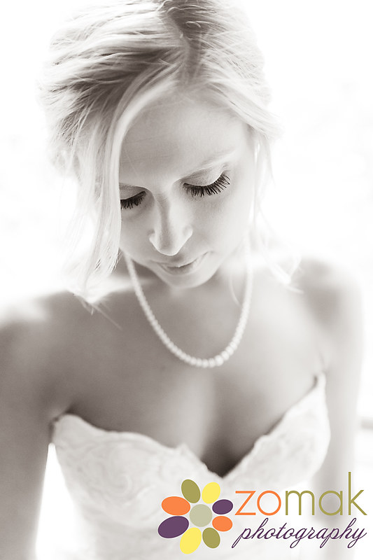 soft black and white portrait of backlit bride before her wedding ceremony