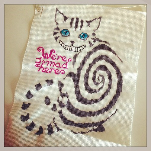 The Chesh needs only whiskers and background now! :) (And I'm thinking of re-doing the mouth.) #crossstitch #cheshirecat #wereallmadhere #aliceinwonderland #colours #colourlove #cat #tabbycat