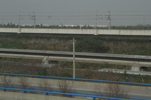 Single track heads off to the depot, with the Shanghai Metro line 2 tracks behind