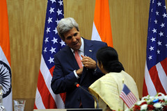 U.S. Secretary of State John Kerry chats with Indian Minister of External Affairs Sushma Swaraj after their news conference that followed the plenary session of a Strategic Dialogue between the two countries in New Delhi, India, on July 31, 2014. [State Department photo/ Public Domain] [State Department photo/ Public Domain]