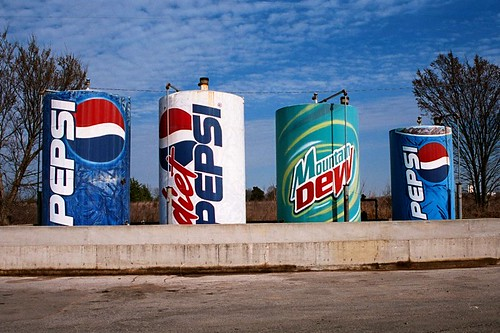 Pick your poison.  These fuel tanks are dressed up like Pepsi cans at a Shell Station south of Halltown