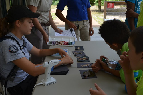 Americorps member, Bonnie, helps kids with their Nature Crafts art projects at First Landing State Park.