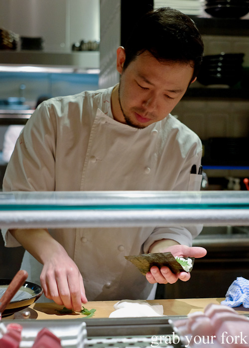 Chef Chase Kojima making a chu-toro and sea urchin roe hand roll at Sokyo at The Star, Pyrmont