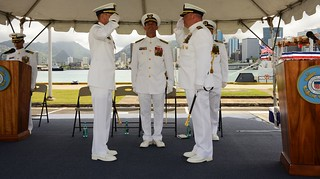 Capt. John W. McKinley and Capt. Robert T. Hendrickson salute after changing command of Coast Guard Cutter Waesche, homeported in Alameda, Calif., presided by Vice Adm. Charles W. Ray, Commander, Pacific Area, at Base Honolulu Aug. 6, 2014. The change of command ceremony of a Coast Guard cutter formally represents the transfer of total responsibility, authority and accountability from one individual to another. U.S. Coast Guard photo by Petty Officer 3rd Class Melissa E. McKenzie.