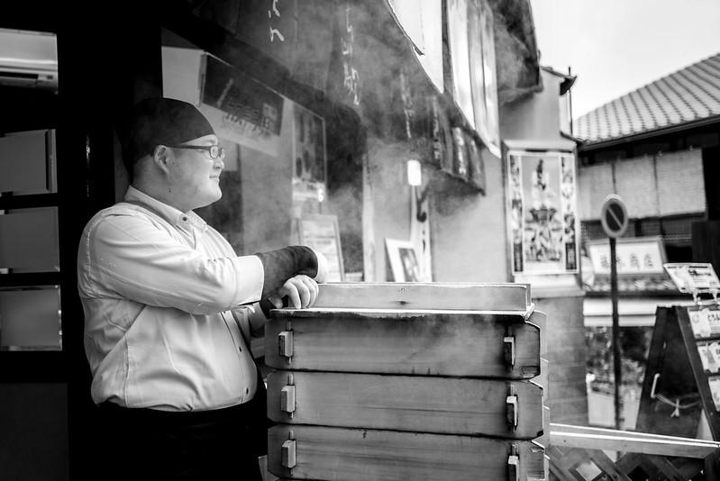 Japanese man selling steam buns