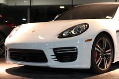 convertible(0.0), automobile(1.0), automotive exterior(1.0), wheel(1.0), vehicle(1.0), performance car(1.0), automotive design(1.0), porsche(1.0), porsche panamera(1.0), bumper(1.0), land vehicle(1.0), luxury vehicle(1.0),