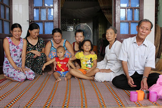 Ho Thi Thiu (second from the right) and her family