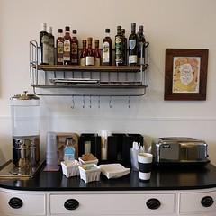#chestofdrawers #coffeebar #condiments #toaster #drinkdispenser #berrybox #berrycrate #shelfie #shelves #bread #bakery #cafe #restaurant #woodinville