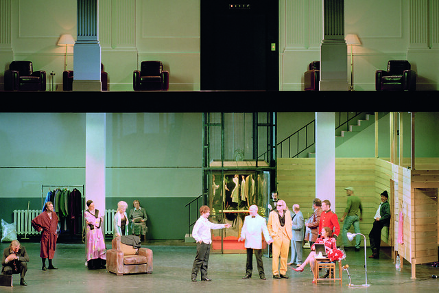 The Prologue of Ariadne auf Naxos, showing the hall of the patron's residence above and the grubby basement in which the artists rehearse below © Rob Moore