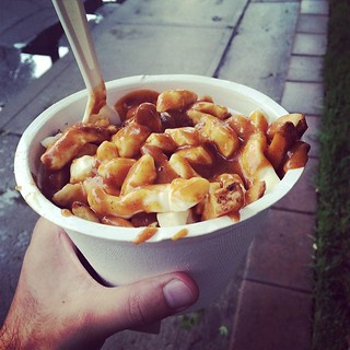 To warm me up after being caught in the down pour. #poutine | by Raj Deut