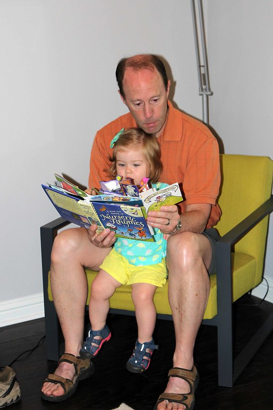 Grandpa reading to Harper