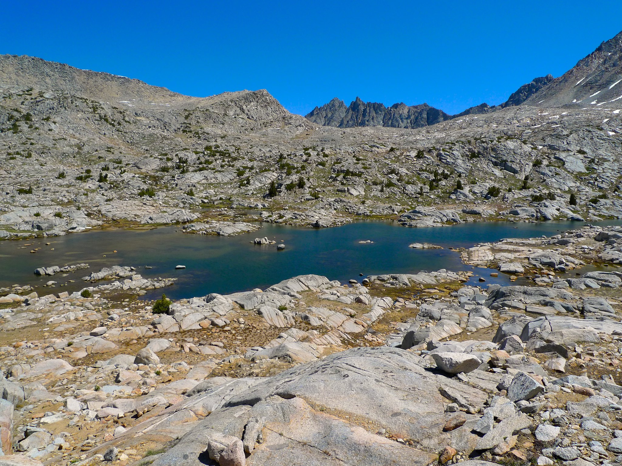 The Inconsolable Range peeks up above Bishop Pass as I make my way eastward off trail to explore upper Dusy Basin