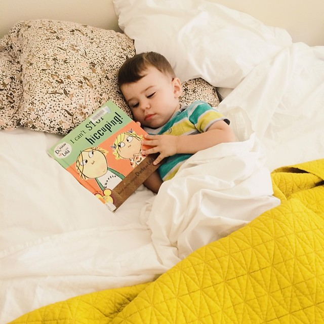 His new favorite book characters are Charlie and Lola. #instaluther #toddler #charlieandlola #britishaccents