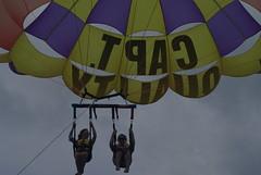 hot air balloon(0.0), wing(0.0), vehicle(0.0), sailing(0.0), hot air ballooning(0.0), toy(0.0), aircraft(1.0), symmetry(1.0), parachute(1.0), sports(1.0), parasailing(1.0), extreme sport(1.0),