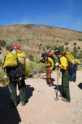 Smokejumpers gather to get instructions prior to heading into a fire. Professionally trained, on-the-ground wildland firefighters are a crucial frontline against wildland fires. (Inciweb.nwcg.gov)