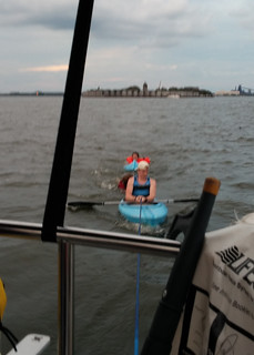 Three kayakers are towed out of Fort McHenry Channel July 19, 2014. The kayakers were in distress in a busy shipping channel.