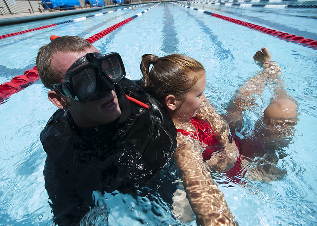 Seaman Jordan Porcella, assigned to USS Russell competes in rescue swimmer events during Surface Line Week