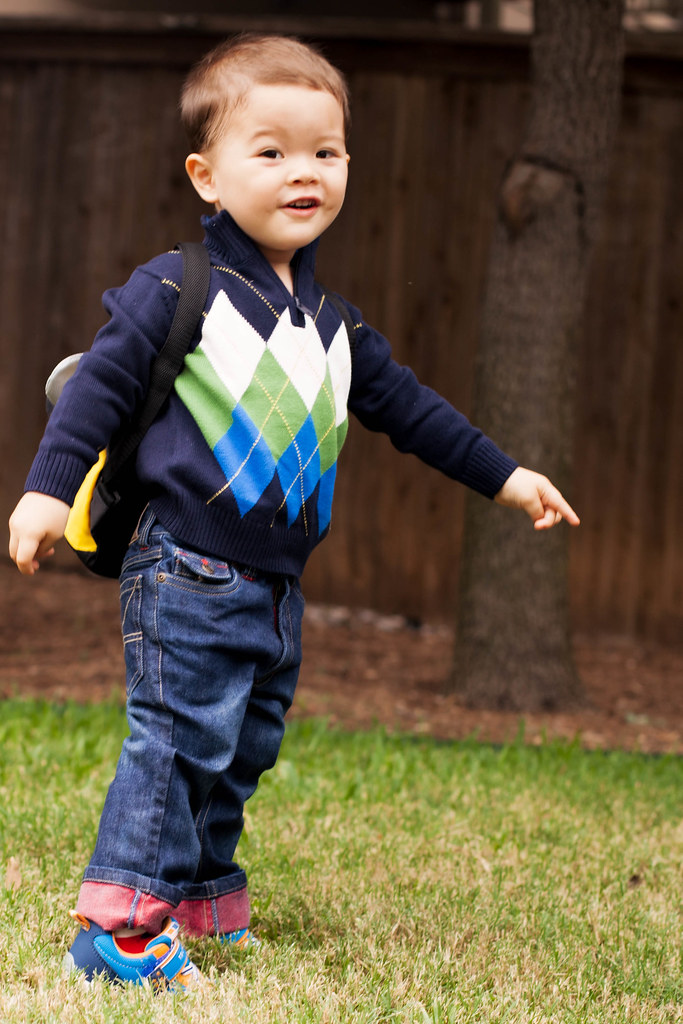cute & little blog | toddler boy fashion | hartstrings argyle sweater, dark rolled jeans, backpack | fall back to school BTS